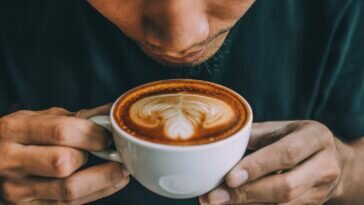 13 Best Keto Drinks – Complete Guide to Low-Carb Drinks close up of man holding coffee cup royalty free image 1598900032 364x205