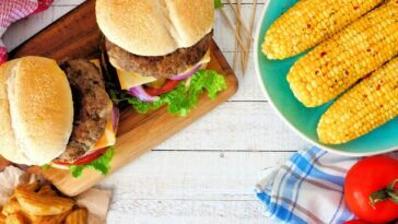 15 Best Low-Carb Hamburger Buns For Keto And Low-Carb Dieters picnic scene with hamburgers corn and potato wedges royalty free image 963011904 1560782646 364x205